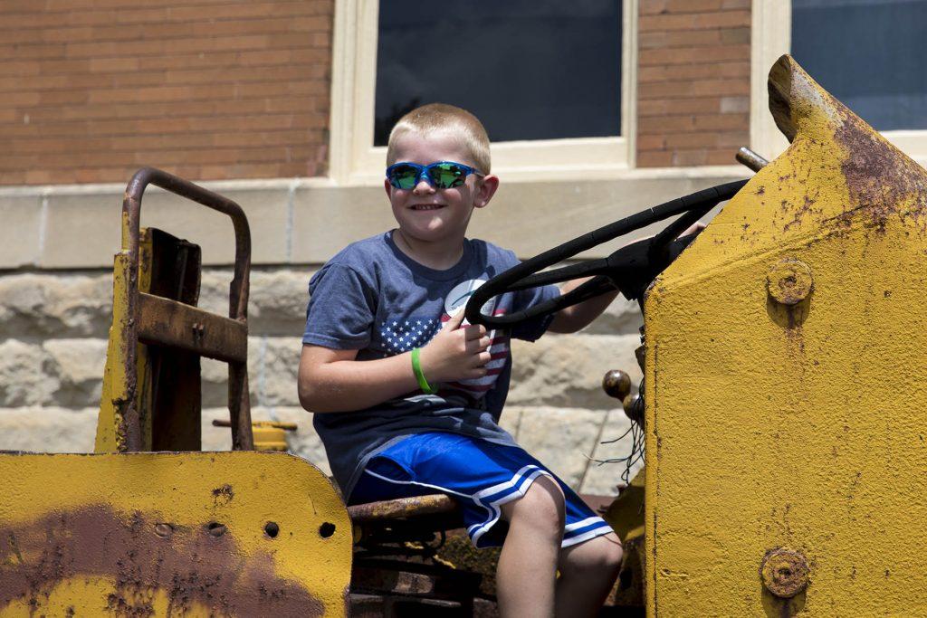 Kid riding big machinery